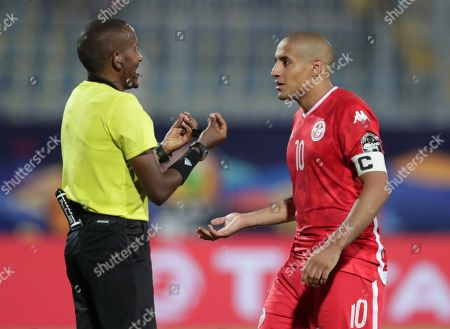 Tunisia's Wahbi Khazri talks to a raferee during the African Cup of Nations semifinal soccer match between Senegal and Tunisia in 30 June stadium in Cairo, Egypt