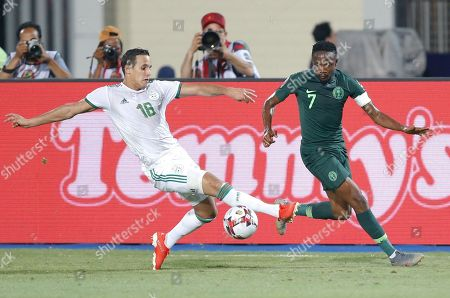 Algeria's Mehdi Zeffane, left, and Nigeria's Ahmed Musa fight for the ball during the African Cup of Nations semifinal soccer match between Algeria and Nigeria in Cairo International stadium in Cairo, Egypt