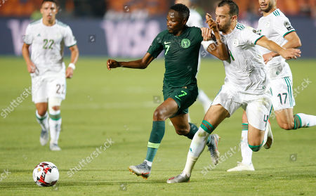 Stock Picture of Nigeria's Ahmed Musa, left, and Algeria's Djamel Eddine fight for the ball during the African Cup of Nations semifinal soccer match between Algeria and Nigeria in Cairo International stadium in Cairo, Egypt