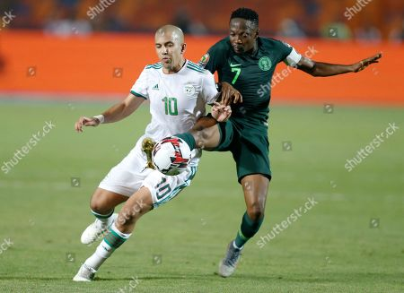 Algeria's Sofiane Feghouli, left, and Nigeria's Ahmed Musa fight for the ball during the African Cup of Nations semifinal soccer match between Algeria and Nigeria in Cairo International stadium in Cairo, Egypt