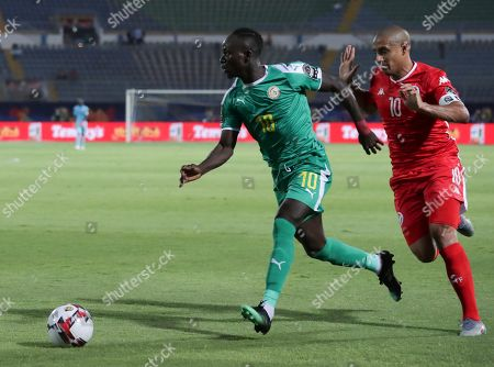 Senegal's Sadio Mane in action in front of TTunisia's Wahbi Khazri during the African Cup of Nations semifinal soccer match between Senegal and Tunisia in 30 June stadium in Cairo, Egypt