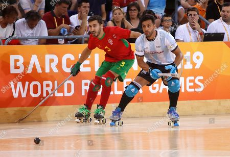Portuguese National Roller Hockey Team's player Jose Rafael Costa (L) fights for the ball with Argentinian Reinaldo Javier Garcia Mallea during men's roller hockey final of World Roller Games in Barcelona, Spain, 14 July 2019.
