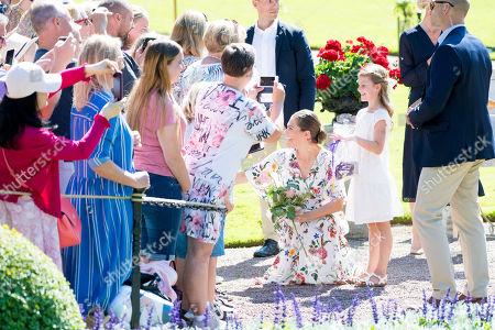 Crown Princess Victoria, Prince Daniel, Princess Estelle and Prince Oscar during the festivities