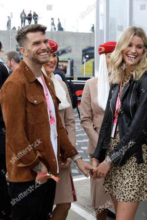 Joel Dommett, Hannah Cooper. Joel Dommett and partner Hannah Cooper during the British Formula One Grand Prix at the Silverstone racetrack, Silverstone, England