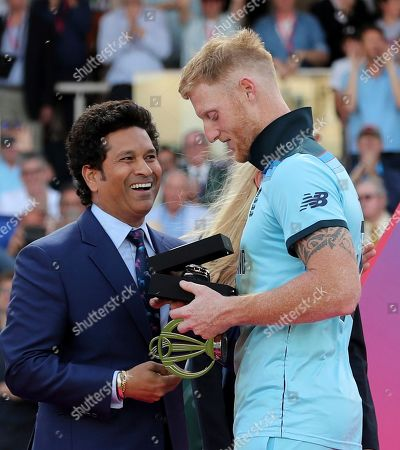 England's Ben Stokes receives the Player of the Match award from former Indian cricketer Sachin Tendulkar after his team won the Cricket World Cup final match between England and New Zealand at Lord's cricket ground in London, England