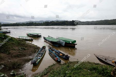Boats stop near the Myitsone area of Ayeyarwaddy river at Ayeyarwaddy Myitsone, near the Myitsone dam project, Myitkyina, Kachin State, 14 July 2019. The Myitsone Dam project began in 2009, when Myanmar was still under the rule of a junta. It was initially scheduled to be completed in 2017. China Power Investment Corporation (CPI), the contractor, had designed the dam to be the world's fifteenth largest hydroelectric power station, producing up to 6,000 megawatts of electricity. 90 percent of that power was to be exported to neighboring Yunnan province in south-west China. The dam, sitting on the Irrawaddy, Myanmar's longest river, was fiercely opposed by the Kachin Independence Organization (KIO), an armed insurgency that has been fighting for the partial autonomy of the Kachin state for the past five decades. In 2011, former Myanmar president Thein Sein announced that the project was to be suspended due to protests from locals and environmentalists.
