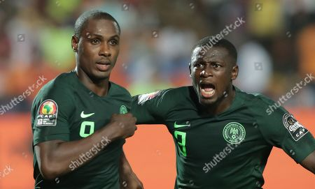 Nigeria's Odion Ighalo (L) celebrates after scoring the 1-1 by penalty during the 2019 Africa Cup of Nations (AFCON) Semi final soccer match between Algeria and Nigeria in Cairo Stadium in Cairo, Egypt, 14 July 2019.