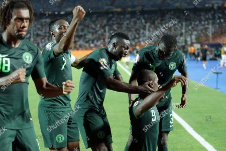 Stock Image of Nigeria's Odion Ighalo (2R) celebrates with teammates after scoring the 1-1 by penalty during the 2019 Africa Cup of Nations (AFCON) Semi final soccer match between Algeria and Nigeria in Cairo Stadium in Cairo, Egypt, 14 July 2019.