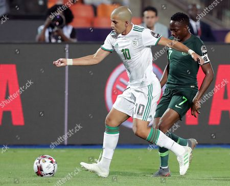 Nigeria's Ahmed Musa (R) in action against Algeria's Sofiane Feghouli during the 2019 Africa Cup of Nations (AFCON) Semi final soccer match between Algeria and Nigeria in Cairo Stadium in Cairo, Egypt, 14 July 2019.