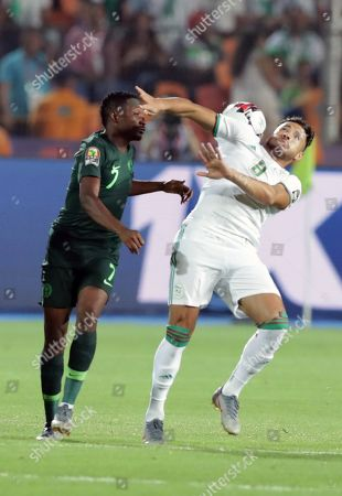 Nigeria's Ahmed Musa (L) in action against Algeria's Mohamed Belaili during the 2019 Africa Cup of Nations (AFCON) Semi final soccer match between Algeria and Nigeria in Cairo Stadium in Cairo, Egypt, 14 July 2019.