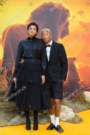 Stock Image of Pharrell Williams (R) with his wife Helen Lasichanh (L) pose on the red carpet at the European premiere of 'The Lion King' in Leicester Square in London, Britain, 14 July 2019. The film will be released in UK theaters on 19 July 2019.