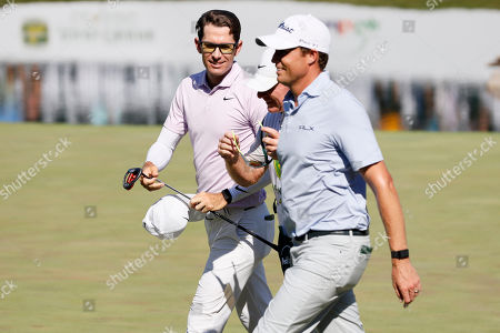 Dylan Frittelli, Nick Watney. Dylan Frittelli, left, walks off the 18th green with Nick Watney, right, after finishing their final round of the John Deere Classic golf tournament, at TPC Deere Run in Silvis, Ill