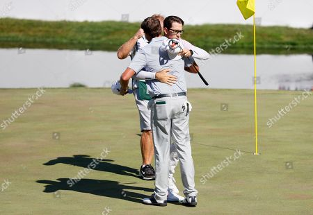 Dylan Frittelli, Nick Watney. Dylan Frittelli gets a hug from Nick Watney, left, after making his putt on the 18th green during the final round of the John Deere Classic golf tournament, at TPC Deere Run in Silvis, Ill