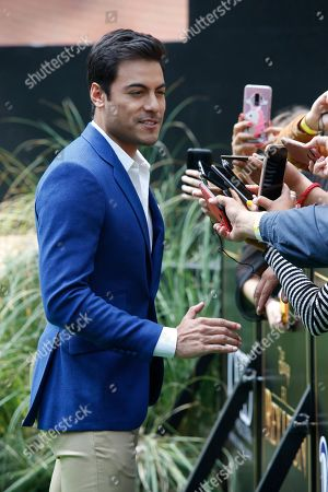 Mexican singer Carlos Rivera, who is the voice of Simba in the Spanish language version of The Lion King, talks to the press during a red carpet event promoting the film in Mexico City