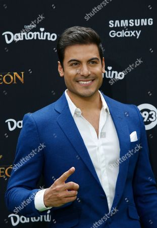 Mexican singer Carlos Rivera, who is the voice of Simba in the Spanish language version of The Lion King, poses during a red carpet event promoting the film in Mexico City