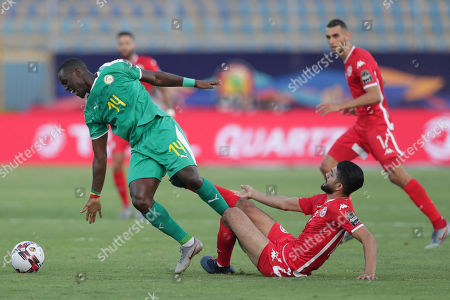 Senegal's Henri Grégoire Saivet, left, is tackled by Tunisia's Ferjani Sassi during the African Cup of Nations semifinal soccer match between Senegal and Tunisia in 30 June stadium in Cairo, Egypt