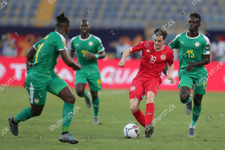Stock Picture of Tunisia's Ayman Ben Mohamed, second right, plays the ball between Senegal's Lamine Gassama, left, and Senegal's Krepin Diatta, right, during the African Cup of Nations semifinal soccer match between Senegal and Tunisia in 30 June stadium in Cairo, Egypt