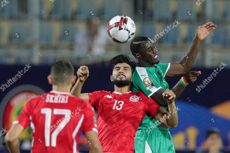 Senegal's Henri Grégoire Saivet, right, jumps for the ball with Tunisia's Ferjani Sassi, center, during the African Cup of Nations semifinal soccer match between Senegal and Tunisia in 30 June stadium in Cairo, Egypt