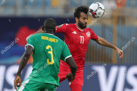 Tunisia's Taha Khenissi, right, heads the ball in front Tunisia's Dylan Bronn during of the African Cup of Nations semifinal soccer match between Senegal and Tunisia in 30 June stadium in Cairo, Egypt
