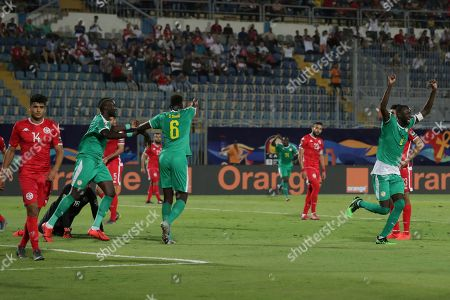 Stock Photo of Senegal players celebrates after Tunisia's Dylan Bronn scores an own goal during the African Cup of Nations semifinal soccer match between Senegal and Tunisia in 30 June stadium in Cairo, Egypt