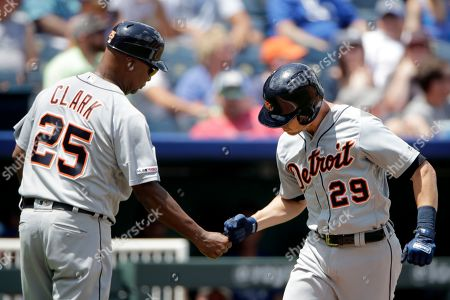 Detroit Tigers' Gordon Beckham (29) celebrates with third base coach Dave Clark (25) after hitting a two-run home run during the third inning of a baseball game against the Kansas City Royals, in Kansas City, Mo