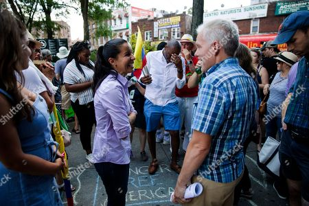 Stock Picture of Tiffany Caban, former Democratic primary candidate for Queens district attorney, center left, speaks with New York City Councilman Jimmy Van Bramer, center right, before the start of a march in opposition to the Trump administration's plans to continue with raids to catch immigrants in the country illegally, in the Queens borough of New York