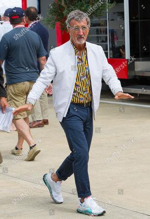 Stock Photo of Eddie Jordan walks through the paddock at Silverstone Circuit.