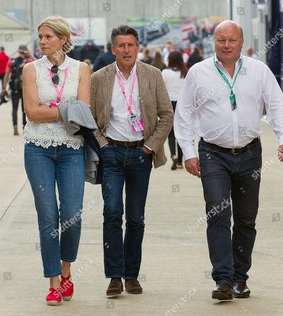 Lord Sebastian Coe walks through the paddock at Silverstone Circuit.