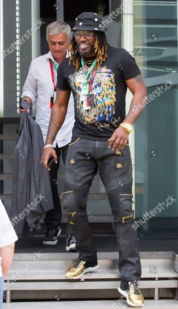 Stock Image of Ex football manager José Mourinho and cricketer Chris Gayle walk through the paddock at Silverstone Circuit.