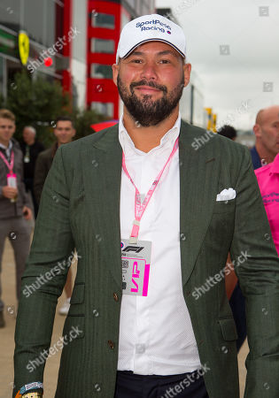 Stock Picture of British former professional boxer Tony Bellew (WBC cruiserweight world champion) walks through the paddock at Silverstone Circuit.