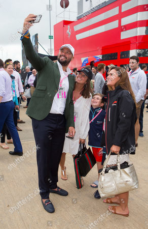 British former professional boxer Tony Bellew (WBC cruiserweight world champion) walks through the paddock at Silverstone Circuit.