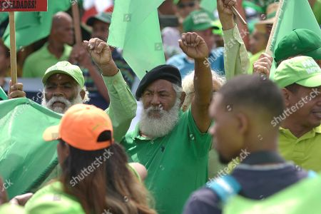Hundreds of Dominicans of the Green March Movement demonstrate in Santiago, Dominican Republic, on 14 July 2019, against corruption and to express their opposition to a constitutional reform that allows president of the Dominican Republic Danilo Medina to run for reelection.