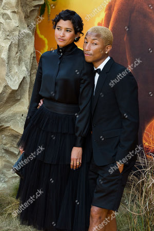 Pharrell Williams (R) and Helen Lasichanh (L) attend the European film premiere of Disney's 'The Lion King' at Odeon Luxe Leicester Square.