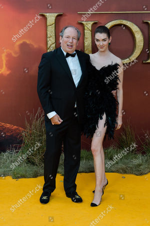 Hans Zimmer and Zoe Zimmer attend the European film premiere of Disney's 'The Lion King' at Odeon Luxe Leicester Square.