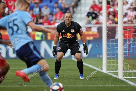 New York Red Bulls goalkeeper Luis Robles, center, watches as New York City FC midfielder Keaton Parks attempts to cross the ball into the box during the first half of an MLS soccer match, in Harrison, N.J. The New York Red Bulls won 2-1