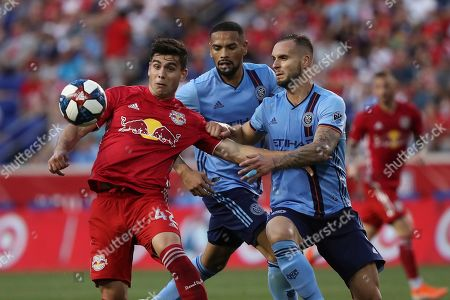 From left, New York Red Bulls forward Brian White, New York City FC defender Alexander Callens, and New York City FC defender Maxime Chanot battle for the ball during the second half of an MLS soccer match, in Harrison, N.J. The New York Red Bulls won 2-1