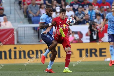 New York Red Bulls forward Brian White, center right, attempts to control the ball while New York City FC defender Sebastien Ibeagha defends during the first half of an MLS soccer match, in Harrison, N.J. The New York Red Bulls won 2-1