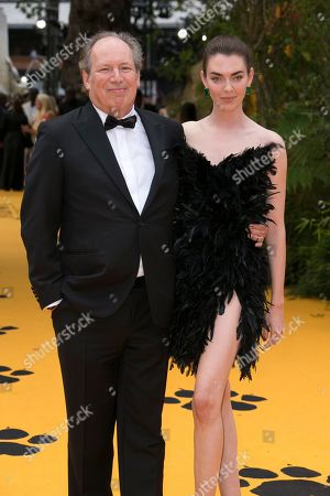 Hans Zimmer, Zoe Zimmer. Hans Zimmer and Zoe Zimmer pose for photographers upon arrival at the 'Lion King' European premiere in central London