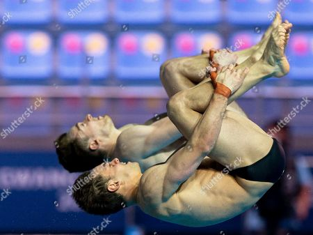 Thomas Daley (front) and Matthew Lee of Britain compete in the Men's 10m Synchro Platform Diving Preliminary at the Gwangju 2019 Fina World Championships in Gwangju, South Korea, 15 July 2019.