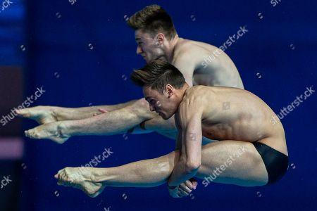 Thomas Daley and Matthew Lee of Great Britain compete in the Men's 10m Synchro Platform Diving Final at the Gwangju 2019 Fina World Championships, Gwangju, South Korea, 15 July 2019.