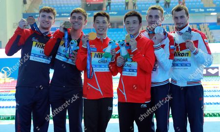 Gold medalists China's Cao Yuan and Chen Aisen, third left, stand with silver medalists Russia's Aleksandr Bondar, right, and Viktor Minibaev and bronze medalists Britain's Thomas Daley and Matthew Lee, left, following the men's 10m platform synchro diving final at the World Swimming Championships in Gwangju, South Korea