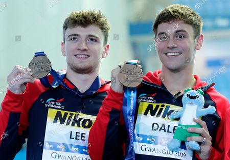 Britain's Thomas Daley, right, and Matthew Lee pose with their bronze medals following the men's 10m platform synchro diving final at the World Swimming Championships in Gwangju, South Korea