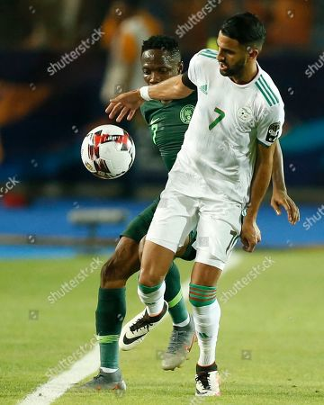 Stock Image of Algeria's Riyad Mahrez, front, fights for the ball with Nigeria's Ahmed Musa during the African Cup of Nations semifinal soccer match between Algeria and Nigeria in Cairo International stadium in Cairo, Egypt