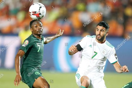 Algeria's Riyad Mahrez, right, fights for the ball with Nigeria's Ahmed Musa during the African Cup of Nations semifinal soccer match between Algeria and Nigeria in Cairo International stadium in Cairo, Egypt