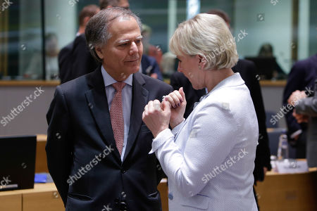 Italian Foreign Minister Enzo Moavero Milanesi (L) and Swedish Foreign Affairs Minister Margot Wallstrom (R) at the start of a EU foreign affairs Council (FAC) at the European Council in Brussels,