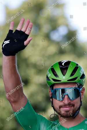 Slovakia's Peter Sagan wearing the best sprinter's green jersey waves to the spectators prior to the start of the tenth stage of the Tour de France cycling race over 217 kilometers (135 miles) with start in Saint-Flour and finish in Albi, France