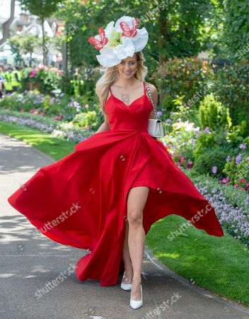 Stock Image of Harriadnie Beau Wearing A Stunning Red Dress Arriving For Ladies Day Of Royal Ascot. 21/06/2018.