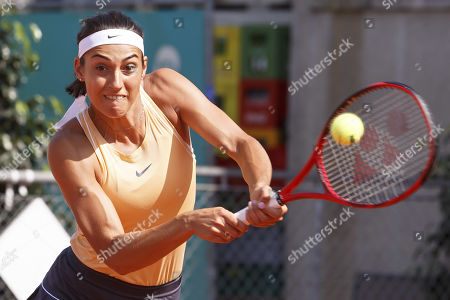 Caroline Garcia, of France, returns a ball to Antonia Lottner, of Germany, during the first round match, at the WTA International Ladies open Lausanne tournament, in Lausanne, Switzerland, Monday, July 15, 2019.