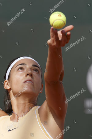 Caroline Garcia, of France, serves a ball to Antonia Lottner, of Germany, during the first round match, at the WTA International Ladies open Lausanne tournament, in Lausanne, Switzerland, Monday, July 15, 2019.