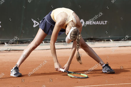 Antonia Lottner, of Germany, reacts after losing a point against Caroline Garcia, of France, during the first round match, at the WTA International Ladies open Lausanne tournament, in Lausanne, Switzerland, Monday, July 15, 2019.
